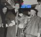 """Guy pose avec la vache Thérèse et son propriétaire Riri lors de l'émission """"Intervilles"""" du 20 février 1964."""